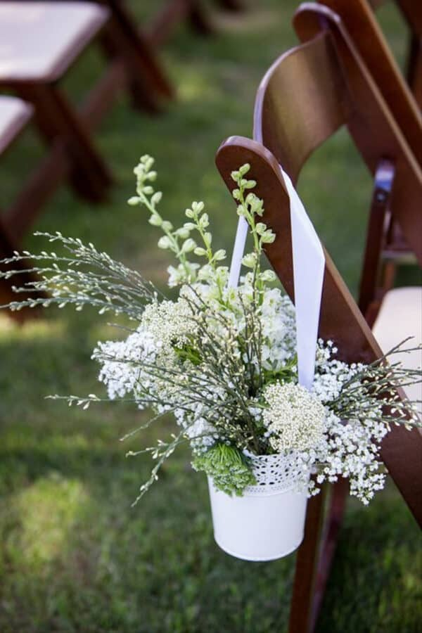 white lace hanging containers with flowers.