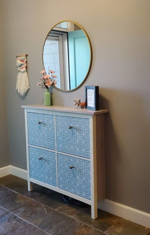 White IKEA Hemnes cabinet with blue patterned drawer fronts.