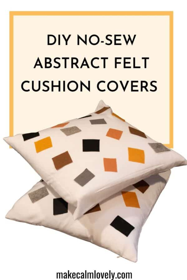 white pillow with colored felt squares