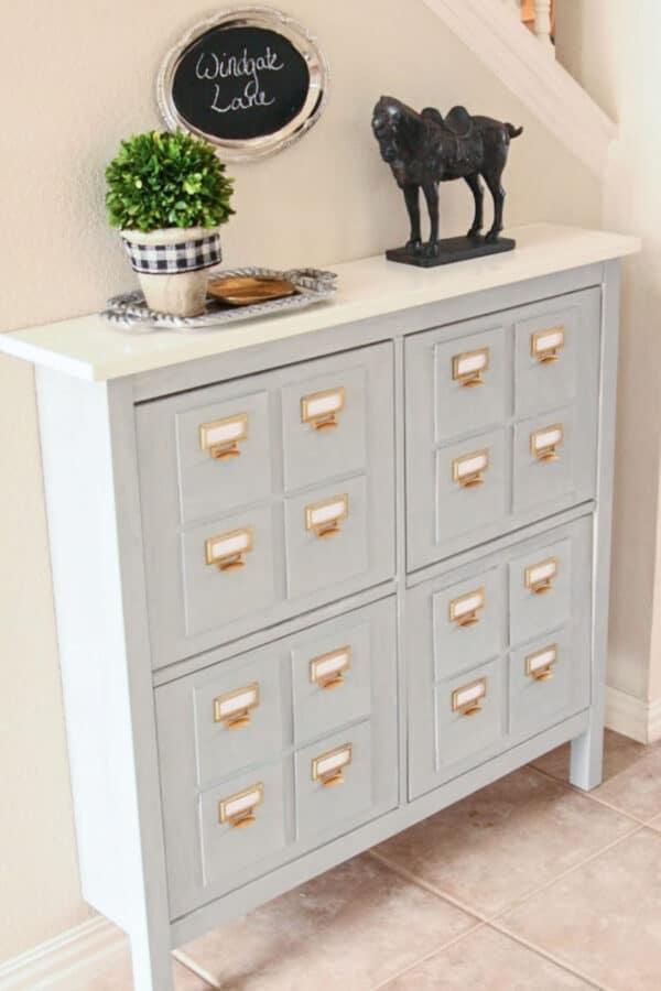 Grey painted IKEA Hemnes unit that looks like antique card catalog.