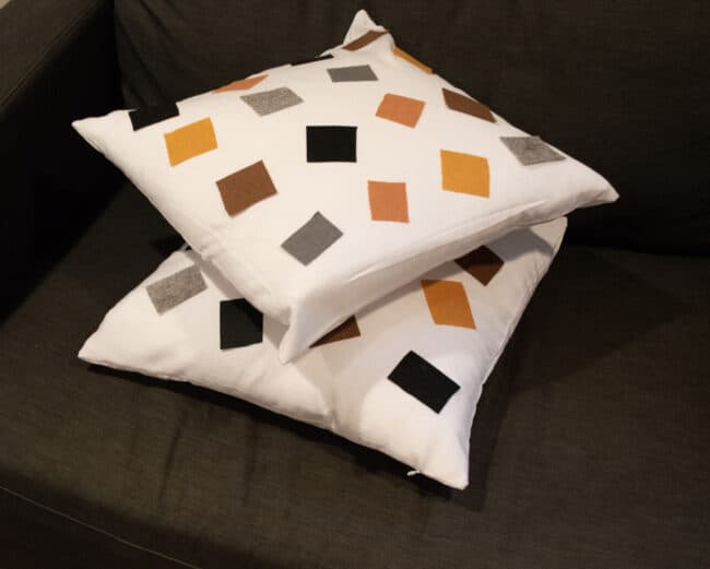 white cushion with colored felt squares