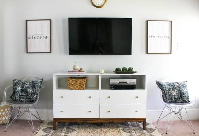 White and wood dresser TV stand.