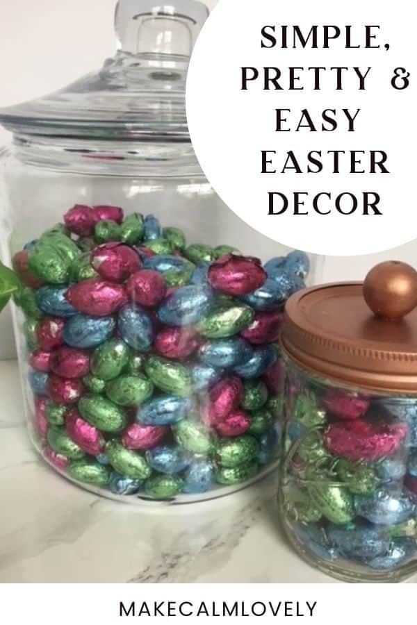 Glass jars full of chocolate eggs.