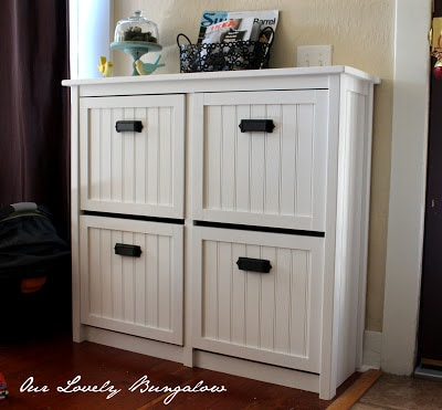 White IKEA Hemnes shoe storage unit with wood panelled drawer fronts.