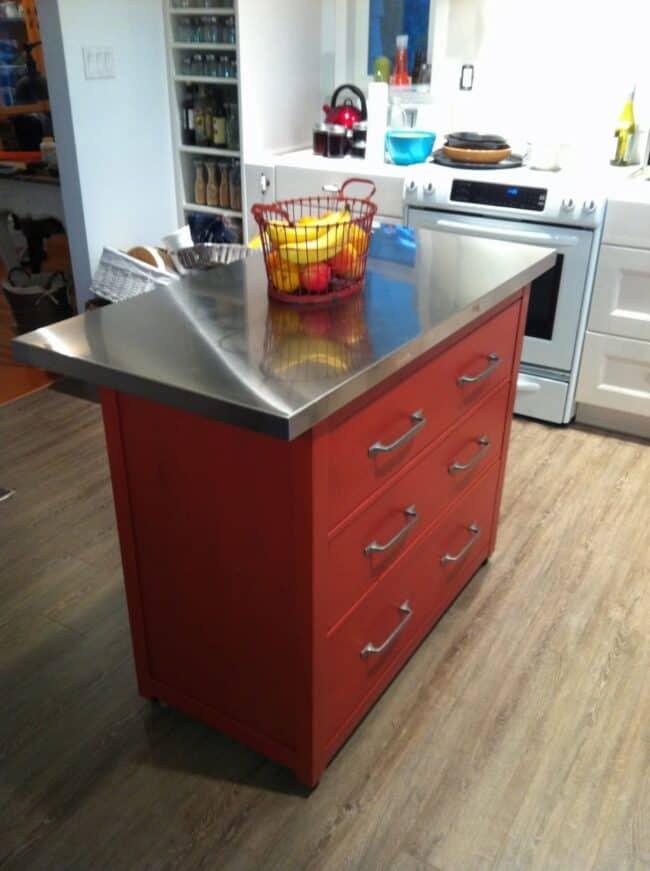 Red IKEA Hemnes kitchen island.