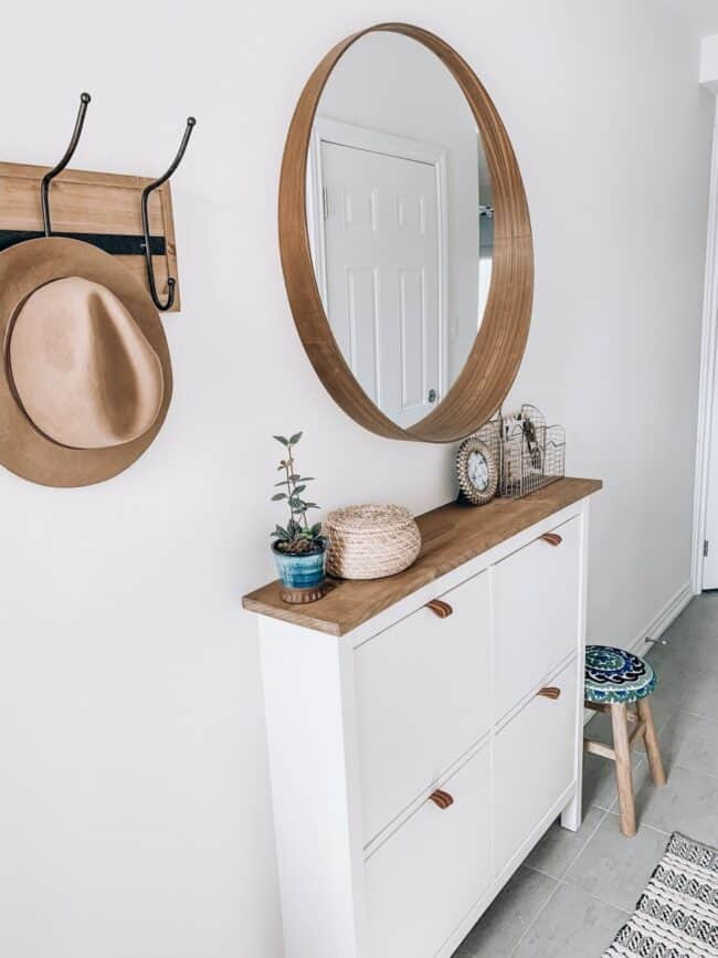 White IKEA Hemnes shoe cabinet.