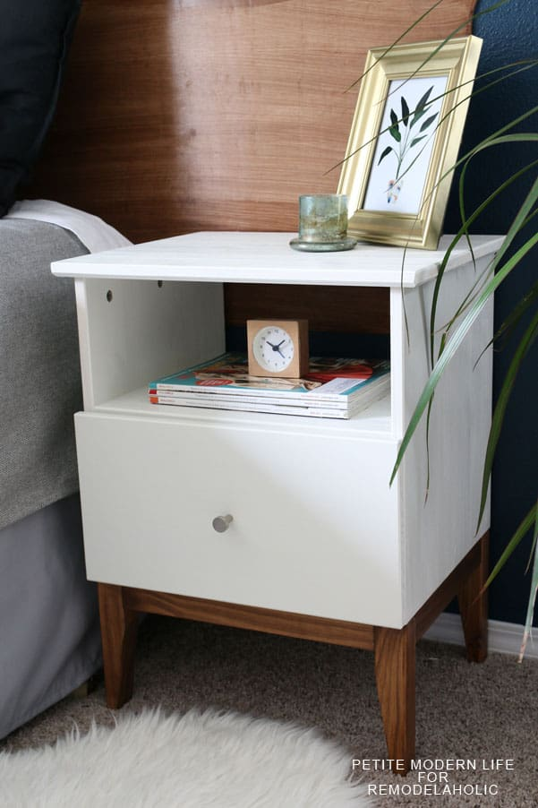 White mid century modern style bedside nightstand.