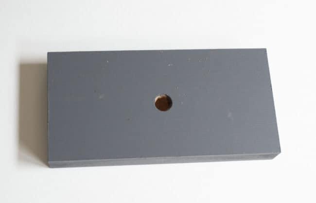 Grey wooden painted block.
