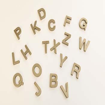 Make glitzy gold alphabet magnets