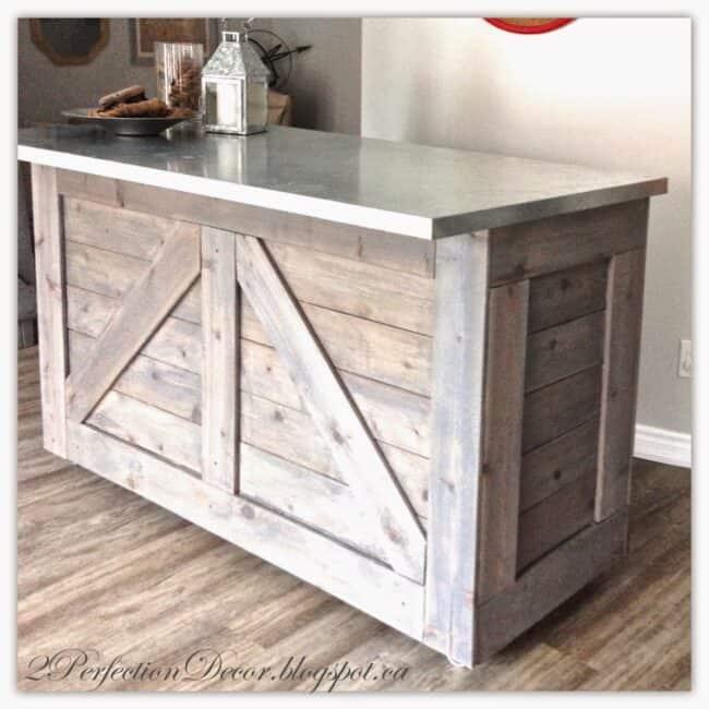 Rustic wooden bar with metal top.