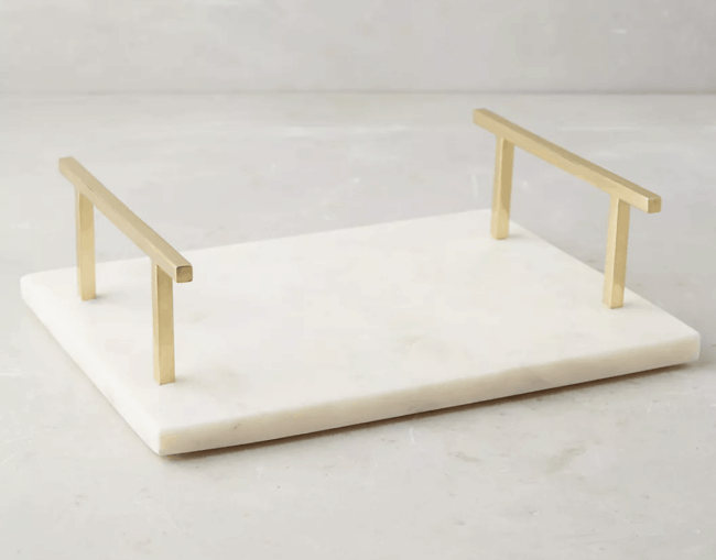 Marble tray with gold handles.