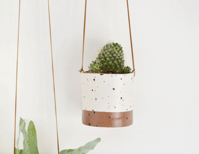 White and brown hanging clay planter.
