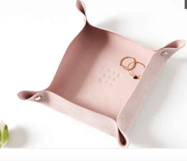 Pink leather valet tray.