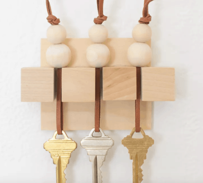 Wooden wall key holder.