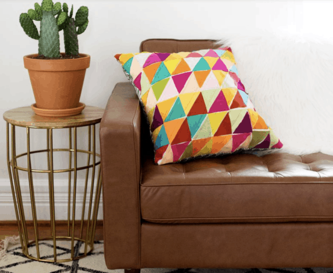 Multicolored geometric fabric felt pillows.