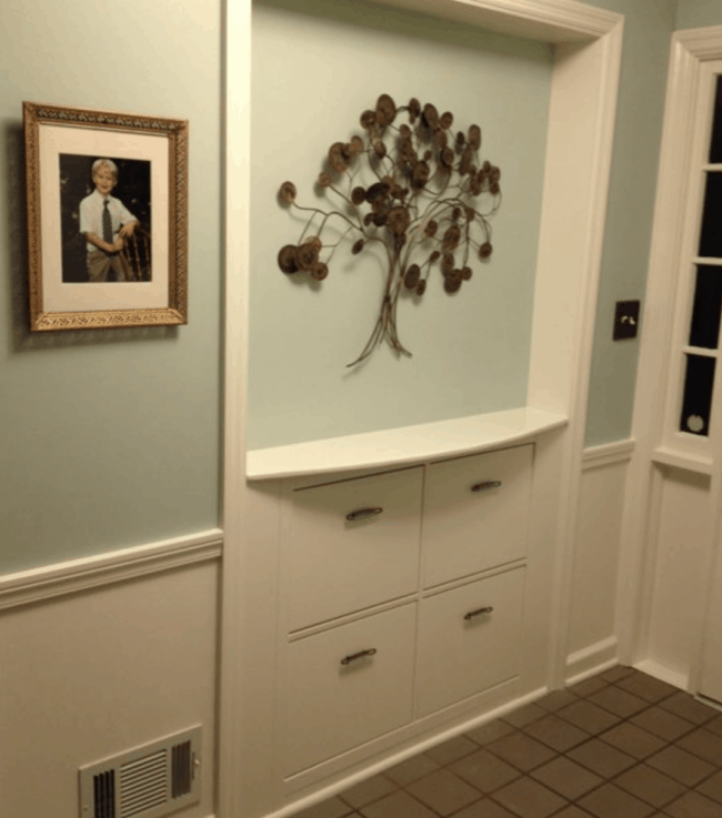 Built in wall shoe cabinet.