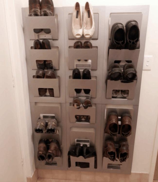 wall mounted magazine racks storing shoes.