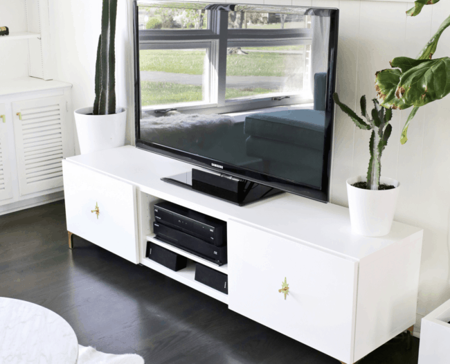 White Mid Century Modern TV stand.