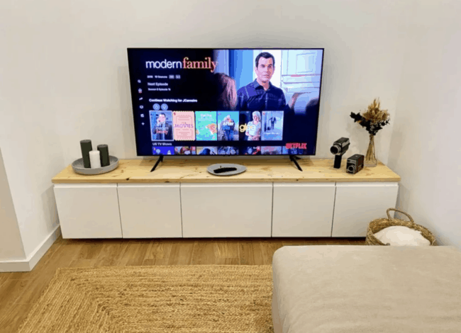White media console with wooden top.