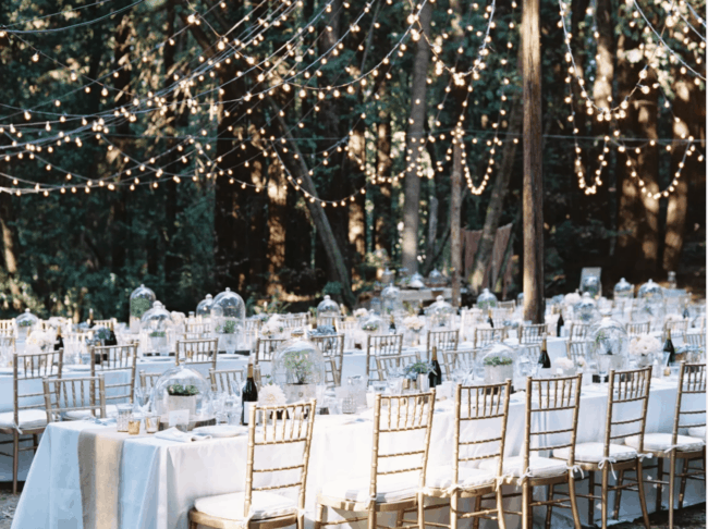 Tables set with string lights above outside.