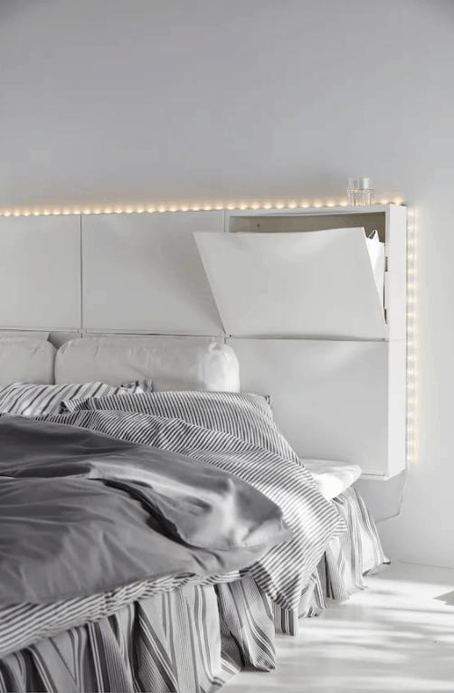 White IKEA Trones unit headboard.