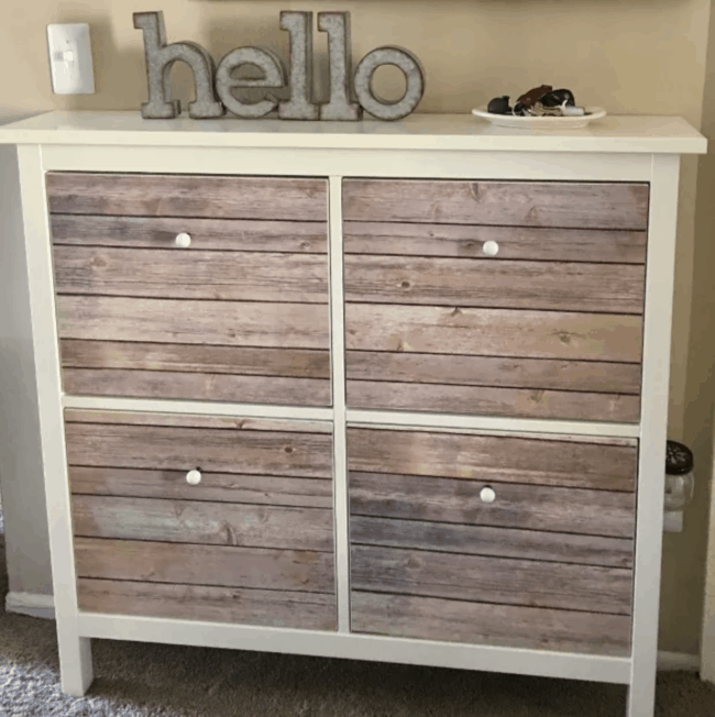 Faux wood front drawers in IKEA Hemnes shoe storage unit.