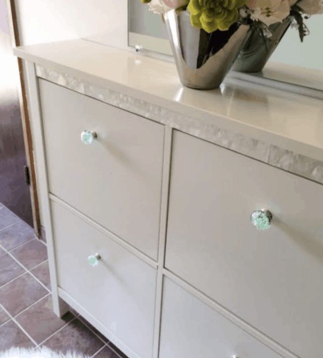 White Hemnes shoe storage unit with mother of pearl strip.