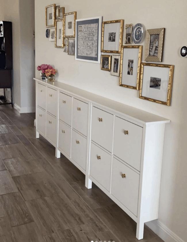 3 IKEA Hemnes shoe storage units together to form long dresser in hallway.