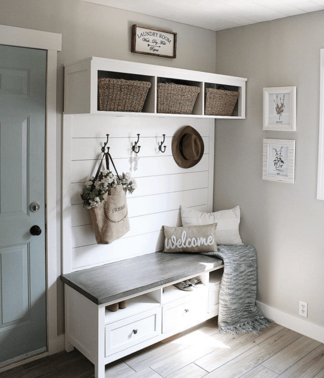 white and brown wood mudroom.