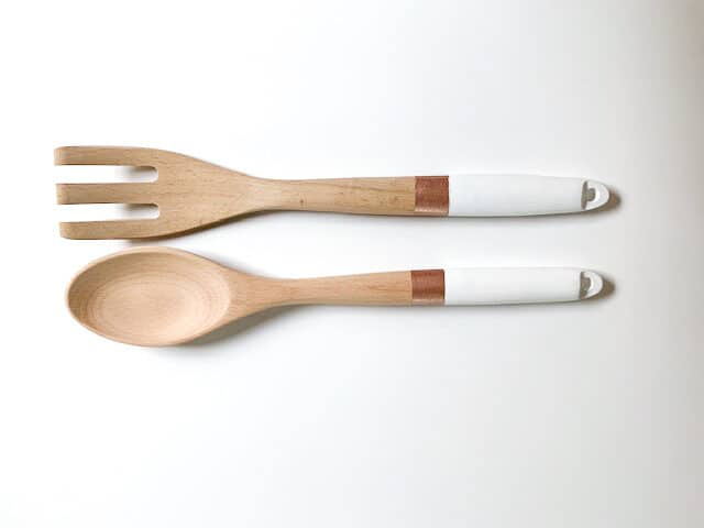 White and bronze painted salad server spoon and fork.