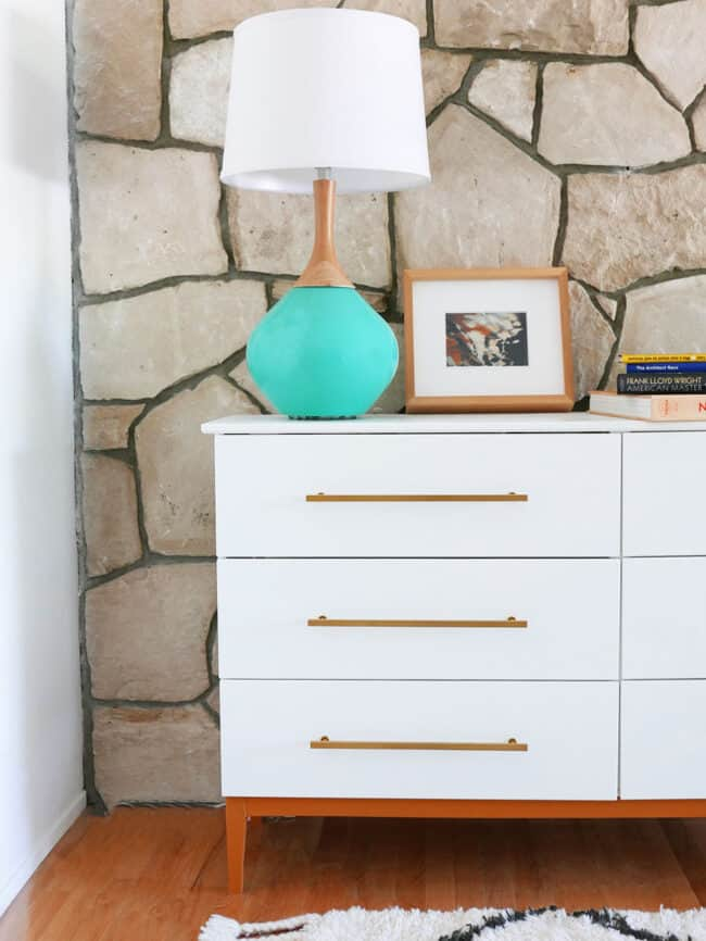 White and gold Mid Century modern dresser.