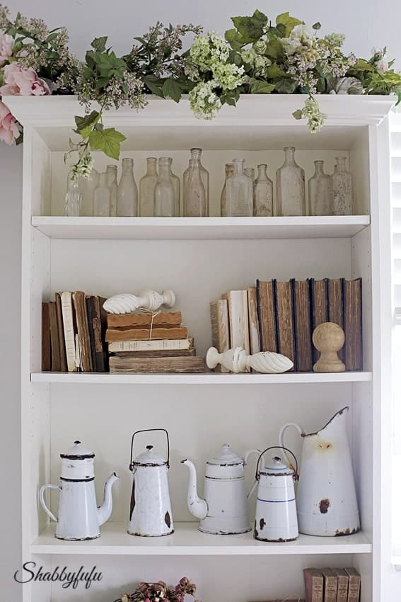 Decorative white wall shelving unit.