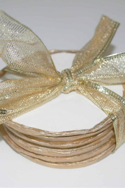 Coasters tied with gold ribbon