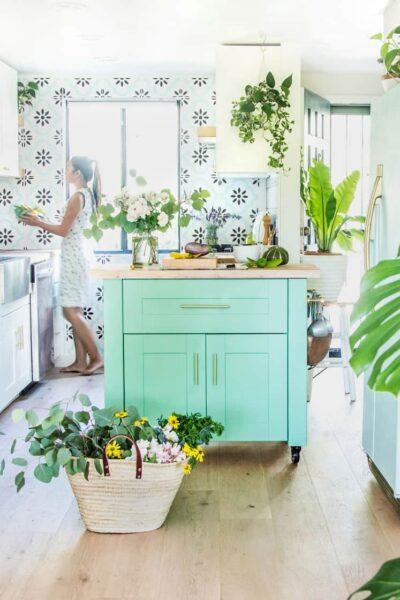 Green painted kitchen island.