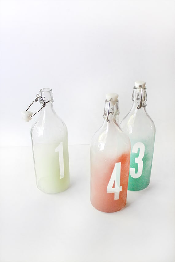 Glass bottles with ombre numbers.