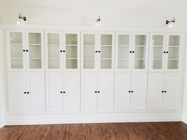 Tall white built-in wall bookcases.