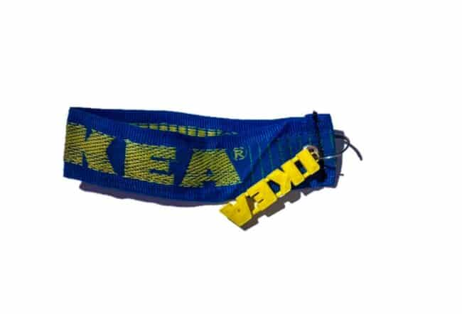 Blue and yellow keychain made from an IKEA bag.
