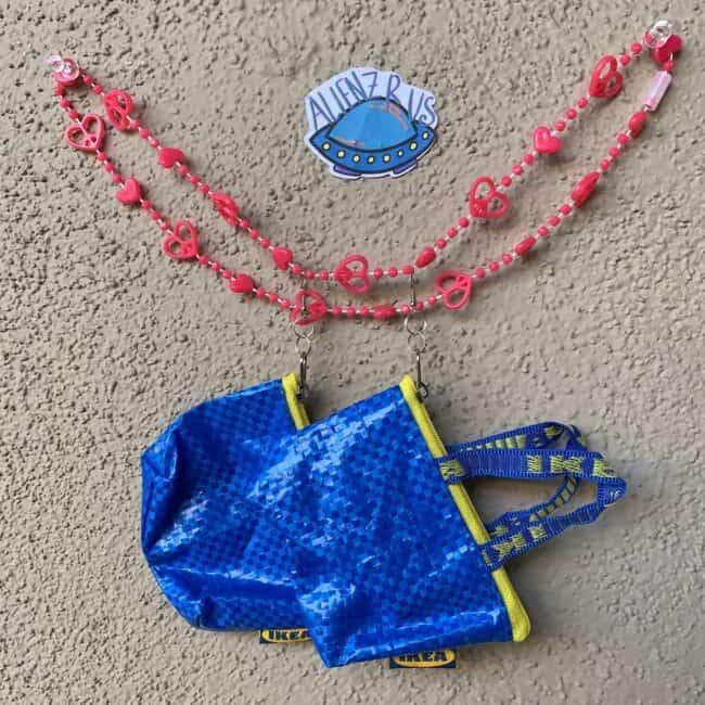 Earrings made from an IKEA blue bag.