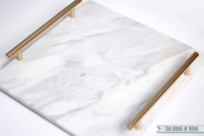 Marble tray with handles.