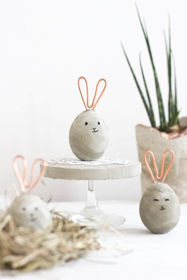 Concrete and copper eggs that look like Easter bunnies.