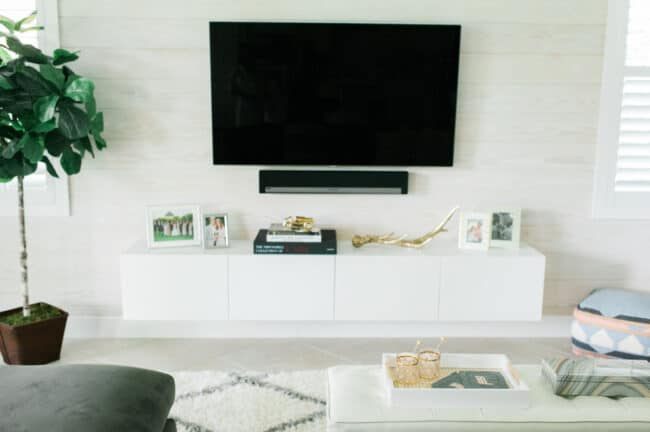 White floating media console.