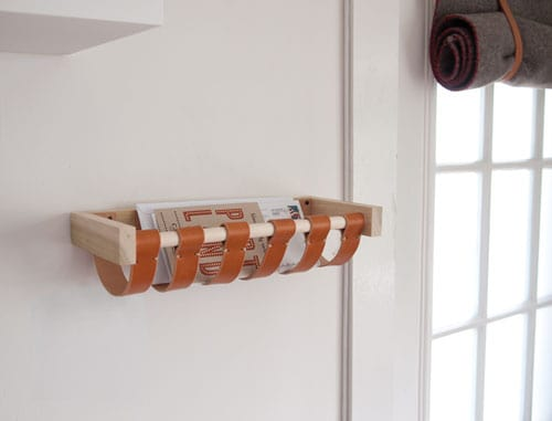 Leather strap wall hanging basket.